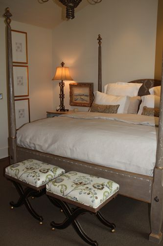 Benches at foot of bed in master