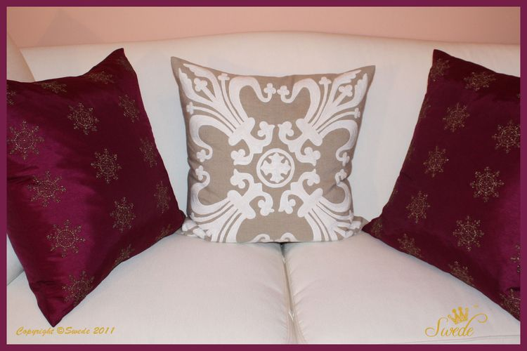 Magenta pillows close up border logo