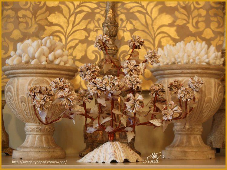Shell sculpture gold borderlogo