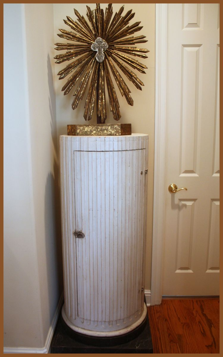 Cross on pedestal cabinet