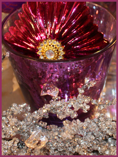 Magenta ornament in votive cup